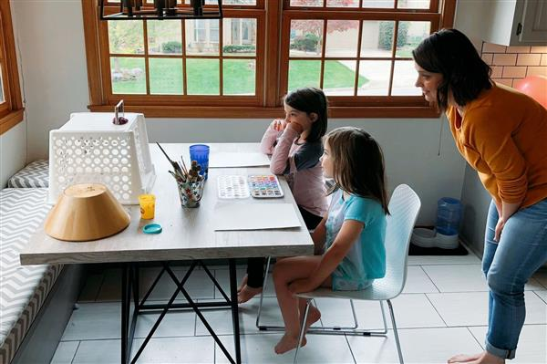 Two children at table working at home