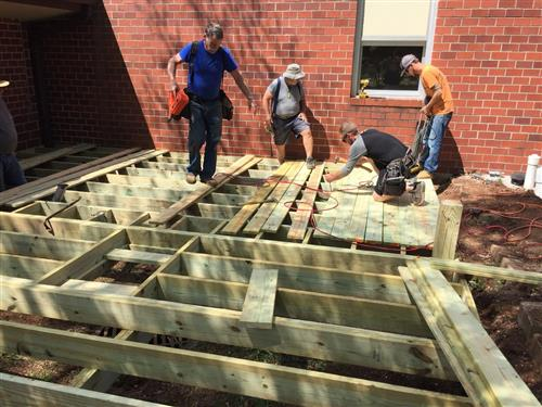Principal, partners and PTA build new deck at Holland Elementary