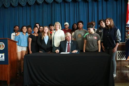 Explore Liberty & Law students see Governor sign a bill into law