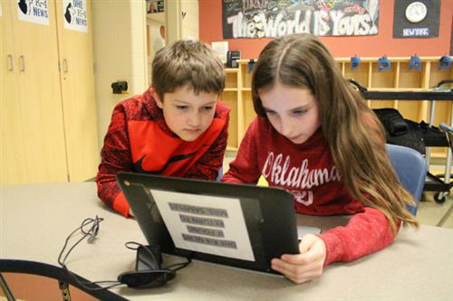 Fourth-graders produce weekly news show at Harrison Elementary
