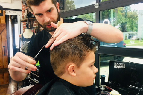 Truman students get free haircuts for back to school, thanks to Rogue Barber