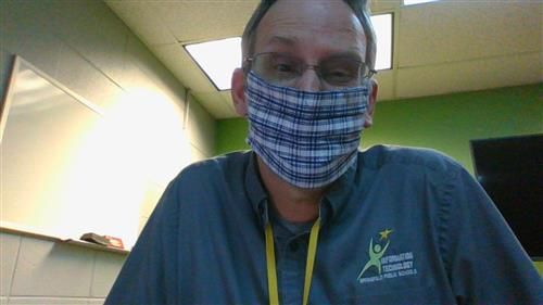 IT tech in face covering